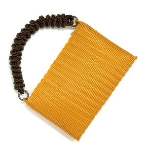 THE KNOT CLUTCH TURMERIC / BLACK