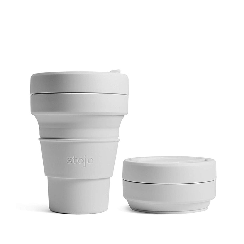 reusable and collapsible coffee cup by stojo in cashmere colour collapsed into a convenient small disk