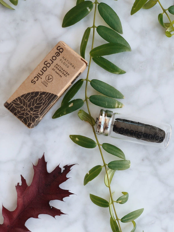 Natural dental floss with activated charcoal by Georganics with its sustainable, plastic free and zero waste packaging