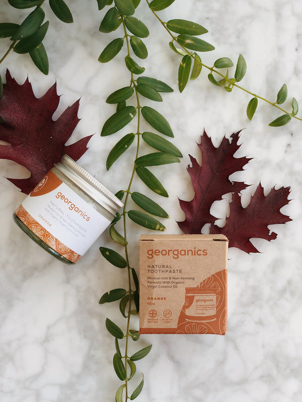 natural and organic toothpaste with orange flavour by georganics with its zero waste packaging