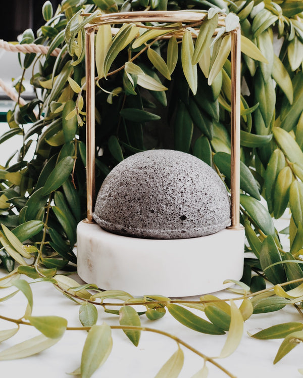 Biodegradable natural and vegan konjac facial sponge with activated bamboo charcoal