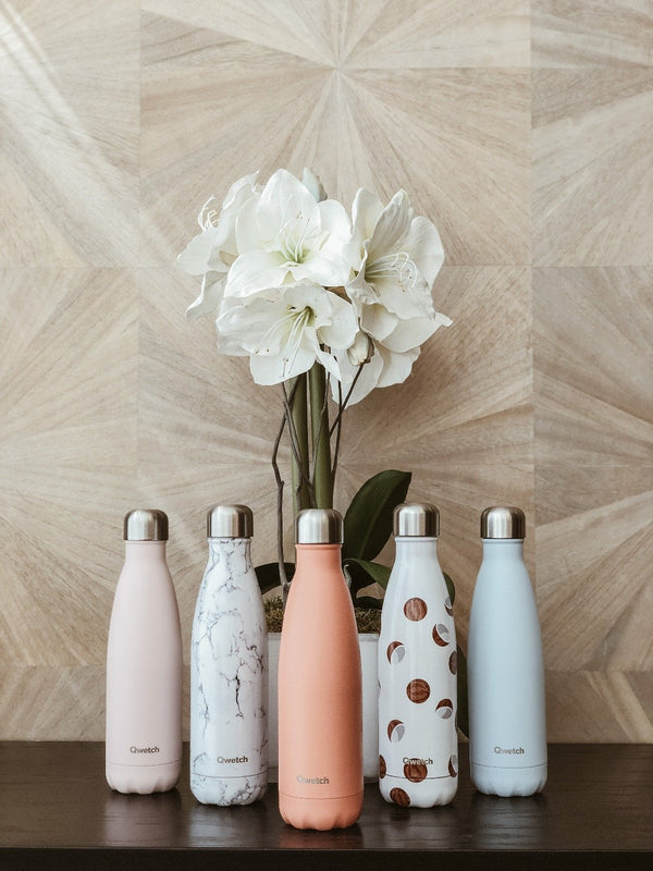 set of 5 colourful insulated stainless steel bottles with an elegant background