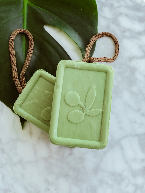Vegan and handmade olive oil soap by olivant in its plastic free packaging