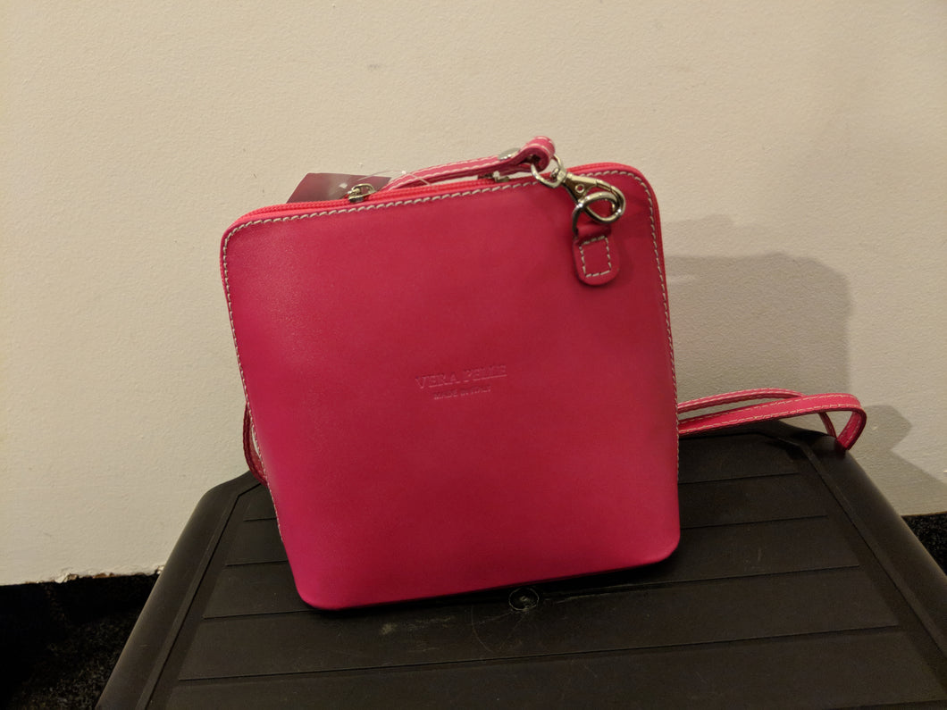 Small leather bright pink handbag
