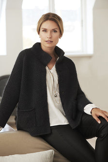 Alma black knitted wool cardigan or light jacket, made in Jensen Yarn and Silk Mohair, the front