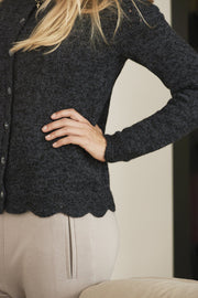 Annabelle knitted cardigan, black with fine details and buttons, detail picture of side and edge