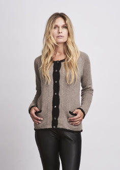 Classic knitted beige cardigan with liberty buttons and pockets, made in Önling no 1 merino wool, the front