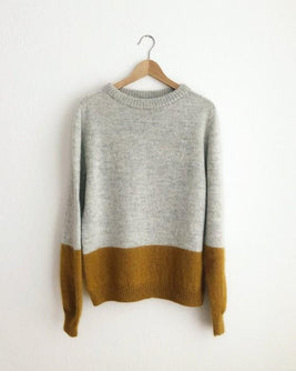 Contrast sweater by PetiteKnit, knitted light grey and yellow sweater, hanging