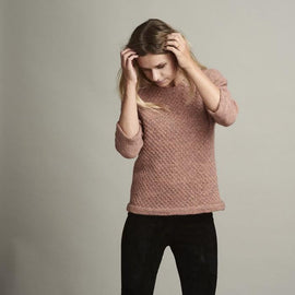Dicte light knitted peach colored sweater with an elegant single color pattern, made in Isager Alapaca and Spinni wool, the front