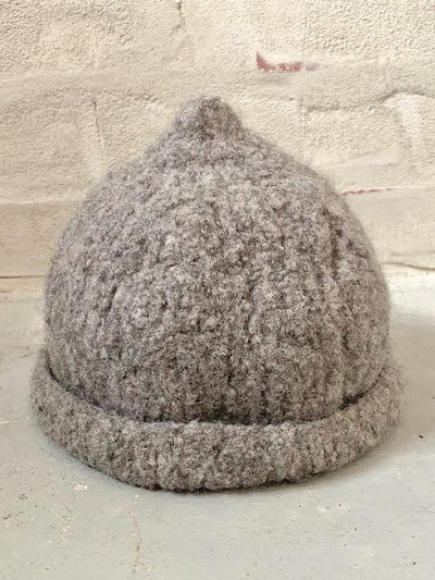 Knitting pattern for a felted hat in organic yarn.