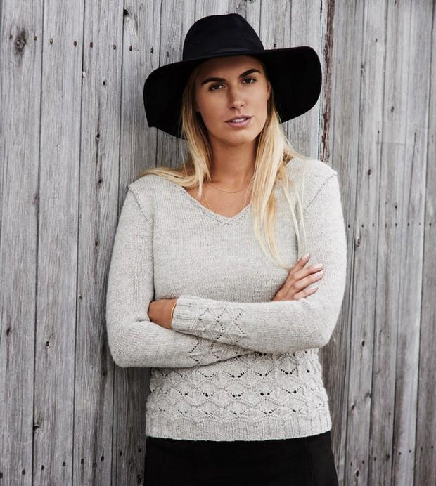Becca light grey V-neck sweater with sea-shell lace pattern at the hem and sleeves, made in Isager Alpaca