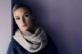 Model wearing Shetland knitted cowl designed by Helga Isager, knitted in Isager Alpaca 2 and Silk Mohair