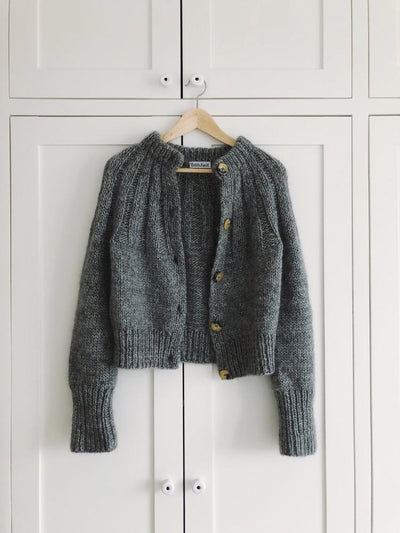 Sunday cardigan by PetiteKnit, dark grey knitted cardigan, hanging