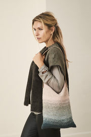 Anva knitted bag with dip-dye color change, knitted in Isager Spinni yarn.