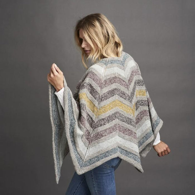 Dia star shaped knitted shawl, grey with stripes in dusty blue, yellow and purple colors, made in Isager Alpaca and Spinni, the back
