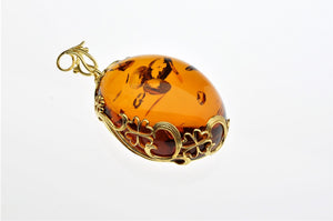 Cognac Baltic See Amber Pendant, decorated with gold plated hand made design, one of a kind