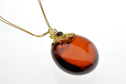 Baltic See Amber Cherry Pendant, decorated with sterling silver gold plated, hand made, one of a kind