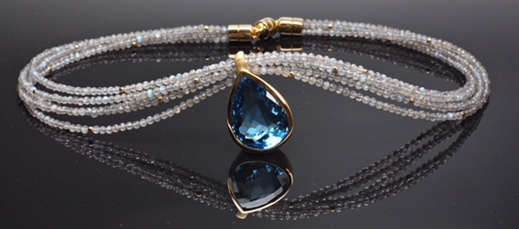 Blue topaz necklace set in sterling silver and gold plated on labradorite beads, very unique cut