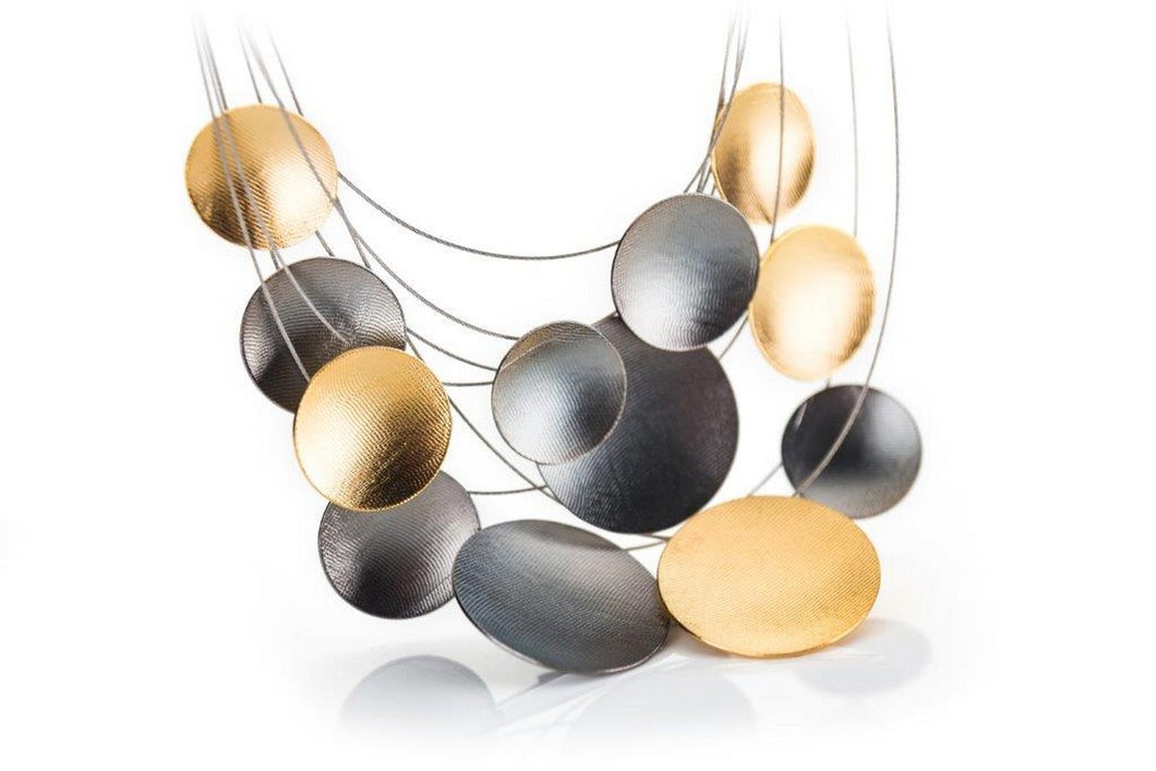 Necklace set in oxidized sterling silver and gold plated