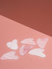 The Unnamed Rose Quartz Gua Sha Massage Tools on Pink Background