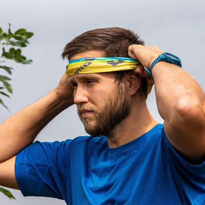 Male Runner Wearing Multi-Use Neck Gaiter for Walking and Jogging as a Head Band