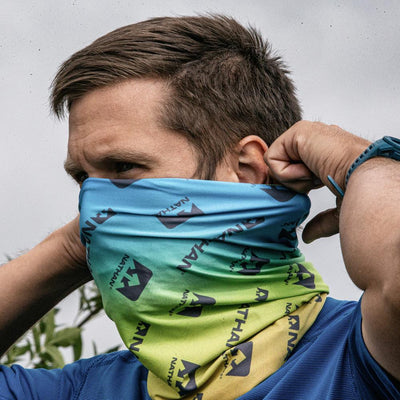 Male Runner Wearing Multi-Use Neck Gaiter for Walking and Jogging as a Face Cover