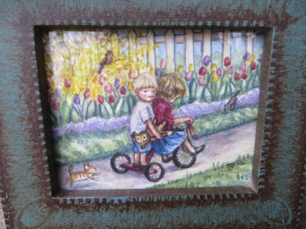 Kids Riding the Tricycle thru the Tulips
