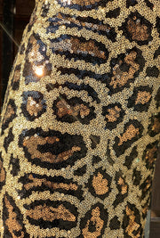 Gold x Teal leopard sequin wide leg pants. Gorgeous waist leopard sequin pants with wide leg bottoms.  Edit alt text