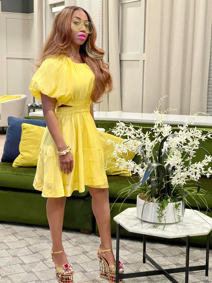 GOLDxTEAL gorgeous yellow puff sleeve dress. Stylish shirt sleeve dress with cutout sides and back.