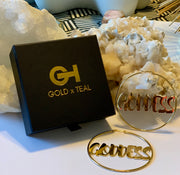 GOLDxTEAL Goddess Gold Hoop Earrings. Stylish gold plated goddess name plate hoop earrings.