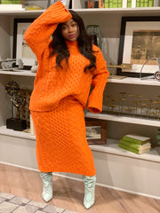 GOLDxTEAL orange chunky sweater skirt set. Gorgeous cable knit midi skirt with matching oversized sweater.