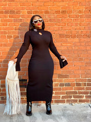 GOLDxTEAL long black knitted dress accented with silver tone chain links.
