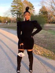 GOLDxTEAL black knit mini dress with princess puff sleeves and mock neck.