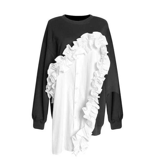 GoldxTeal ruffle sweatshirt. Front ruffle button up shirt with sweatshirt sleeves and back. A stylish black and white sweatshirt to pair with any bottoms.