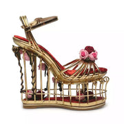 GOLDxTEAL Enchanted Wedge Sandals. Gold cage sandals accents with intertwined flowers.