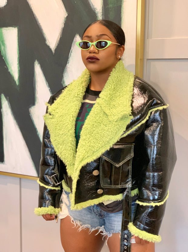 GOLDxTEAL faux patent leather shearling jacket trimmed with lime green faux shearling.