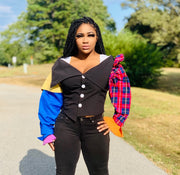 GOLDxTEAL KiKi Crop Top. Vibrant colored asymmetrical crop top with plaid patchwork and ruffle accents on the sleeves.