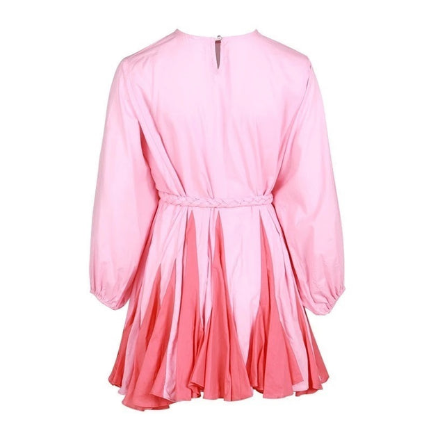 GoldxTeal pink mini dress with puff sleeves.