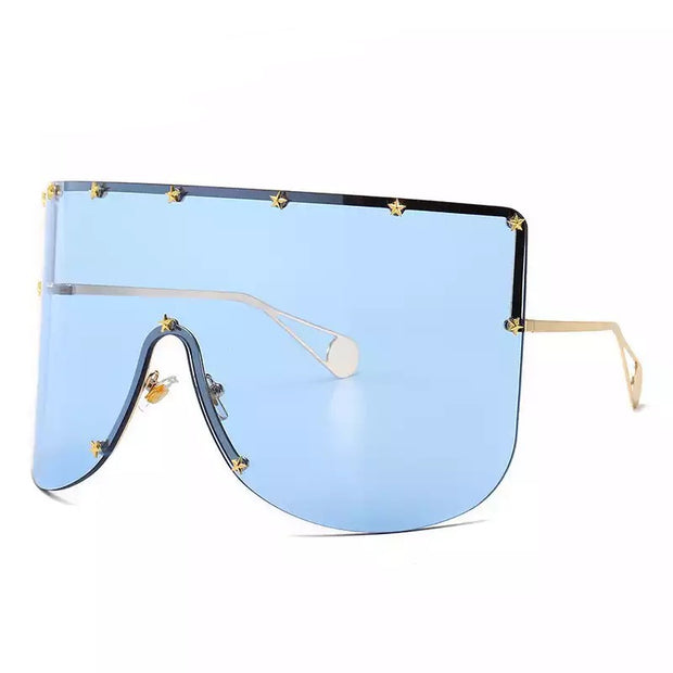 GOLDxTEAL Star studded Oversized Sunglasses. Stylish oversized sunglasses with a blue tint, accented with gold tone hardware.