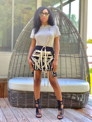 GOLDxTEAL Mobb Tyz mini skirt. Modern statement mini skirt with tonal from laces with side pockets.