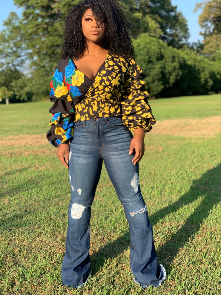 GOLDxTEAL Well Bloomed Wrap Top. Vibrant colored mix floral print top with three quarter inch sleeves with ruching details.