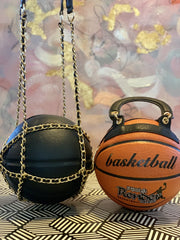 GOLDxTEAL Onyx Purse with gold chains.