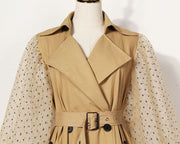 Gold x Teal women's fashion trench coat. Belted waist and dramatic sleeves.