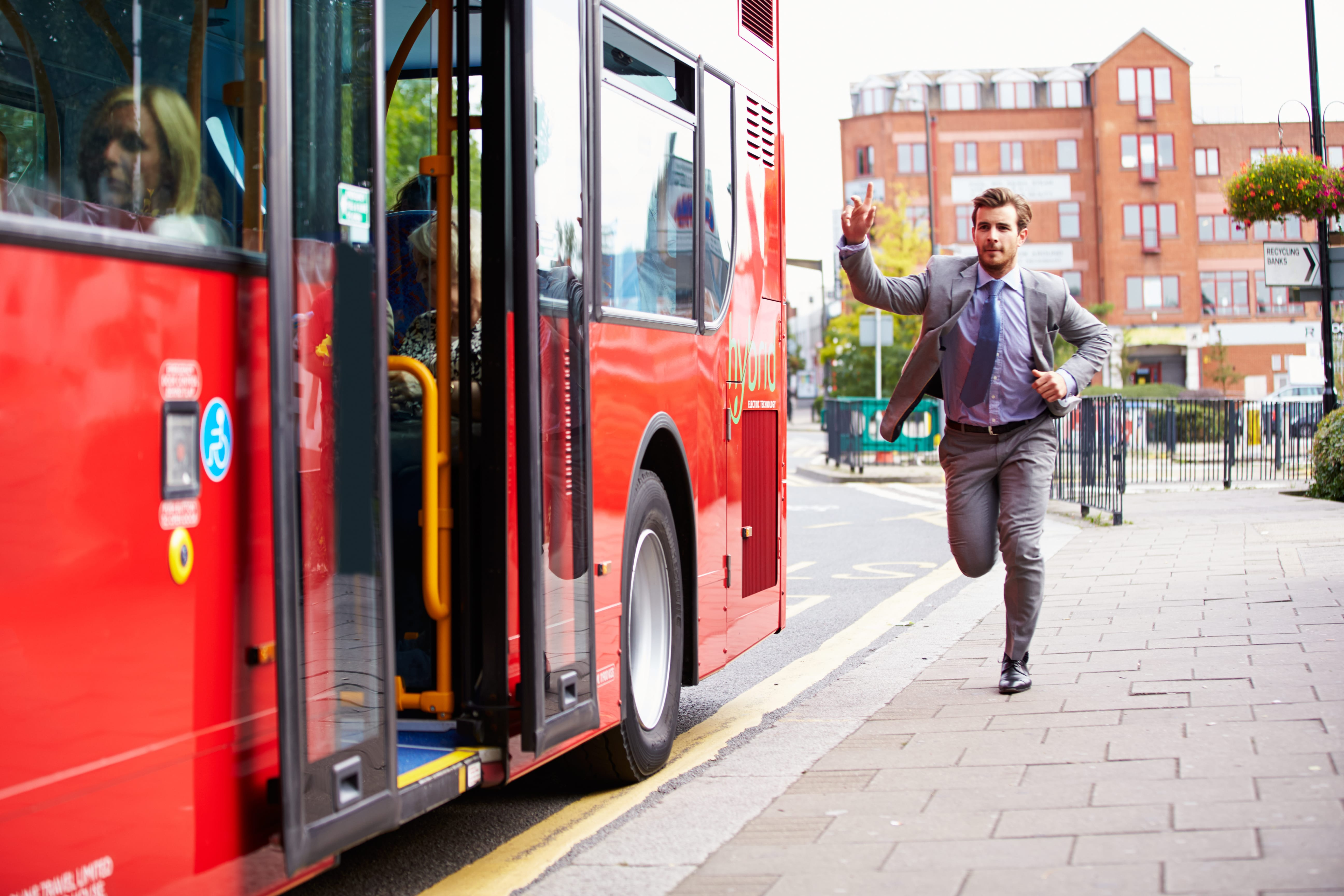 Businessman Running To Catch Bus Stop