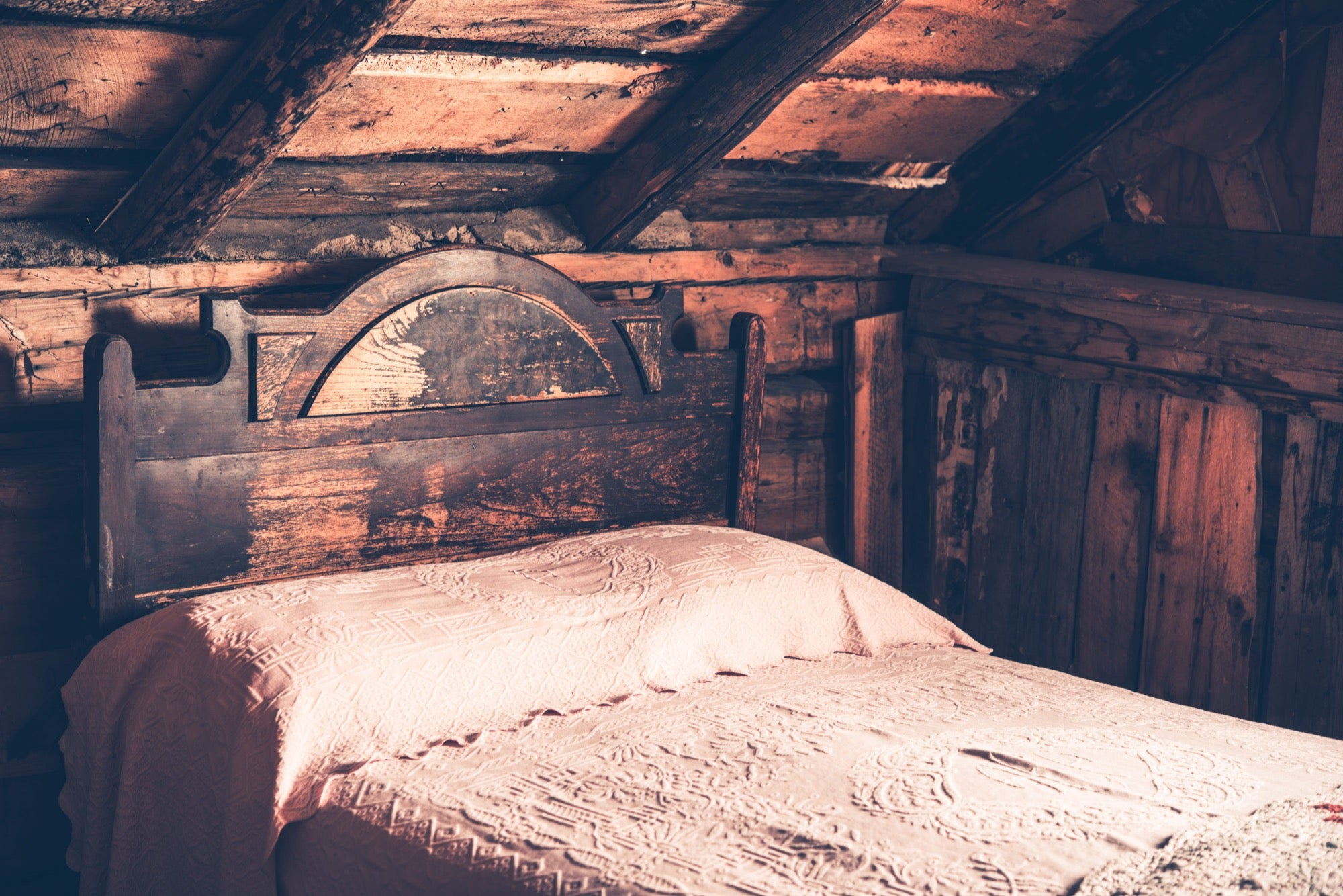 Old Wooden Cabin Bedroom. Aged Cabin Bed.