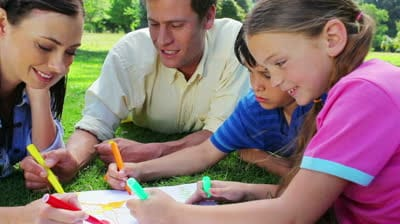 stock-footage-smiling-family-coloring-together-in-the-countryside