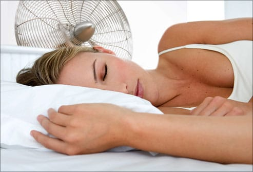 getty_rf_photo_of_woman_sleeping_with_electric_fan