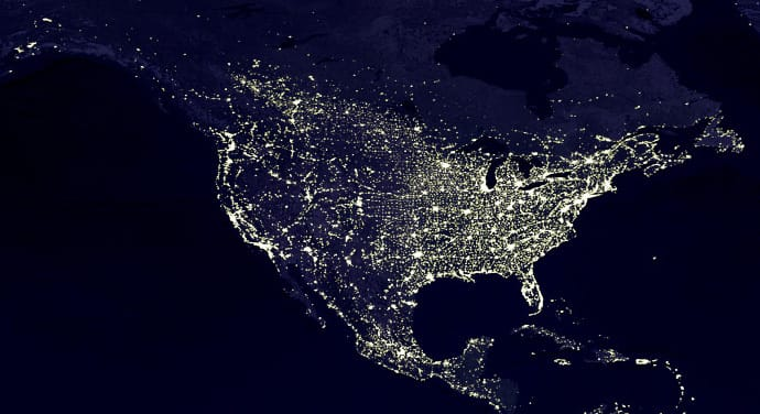 EARTH'S CITY LIGHTS 		Credit Data courtesy Marc Imhoff of NASA GSFC and Christopher Elvidge of NOAA NGDC. Image by Craig Mayhew and Robert Simmon, NASA GSFC. This image of Earth's city lights was created with data from the Defense Meteorological Satellite Program (DMSP) Operational Linescan System (OLS). Originally designed to view clouds by moonlight, the OLS is also used to map the locations of permanent lights on the Earth's surface. The brightest areas of the Earth are the most urbanized, but not necessarily the most populated. (Compare western Europe with China and India.) Cities tend to grow along coastlines and transportation networks. Even without the underlying map, the outlines of many continents would still be visible. The United States interstate highway system appears as a lattice connecting the brighter dots of city centers. In Russia, the Trans-Siberian railroad is a thin line stretching from Moscow through the center of Asia to Vladivostok. The Nile River, from the Aswan Dam to the Mediterranean Sea, is another bright thread through an otherwise dark region. Even more than 100 years after the invention of the electric light, some regions remain thinly populated and unlit. Antarctica is entirely dark. The interior jungles of Africa and South America are mostly dark, but lights are beginning to appear there. Deserts in Africa, Arabia, Australia, Mongolia, and the United States are poorly lit as well (except along the coast), along with the boreal forests of Canada and Russia, and the great mountains of the Himalaya. The Earth Observatory article Bright Lights, Big City describes how NASA scientists use city light data to map urbanization.