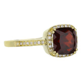 Garnet And Diamond Halo Ring in Yellow Gold
