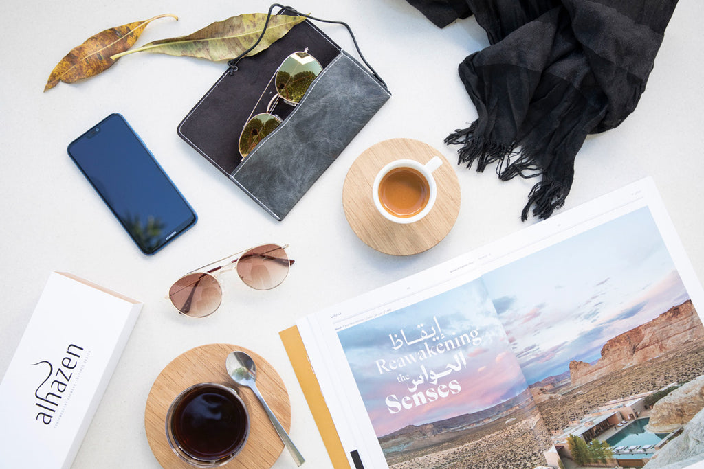 Alhazen sunglasses eyewear on tabletop coffee lifestyle flatlay